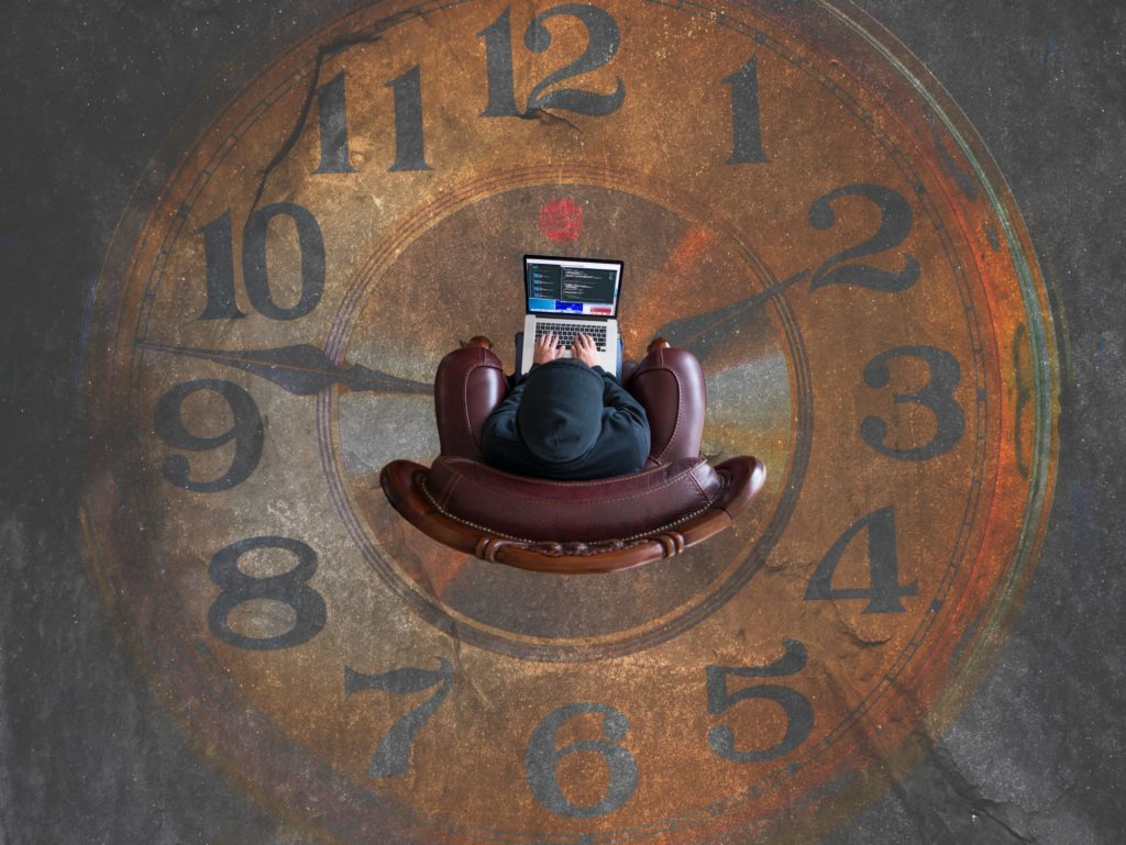clock with person in a couch